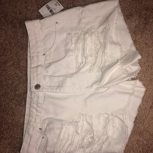 All white super distressed shorts